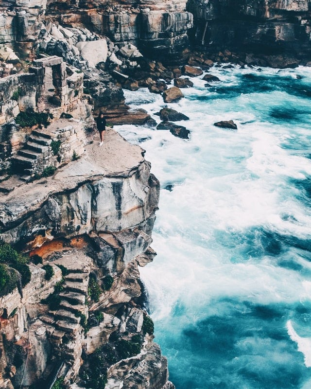 broken stairs climbing a cliff by the sea