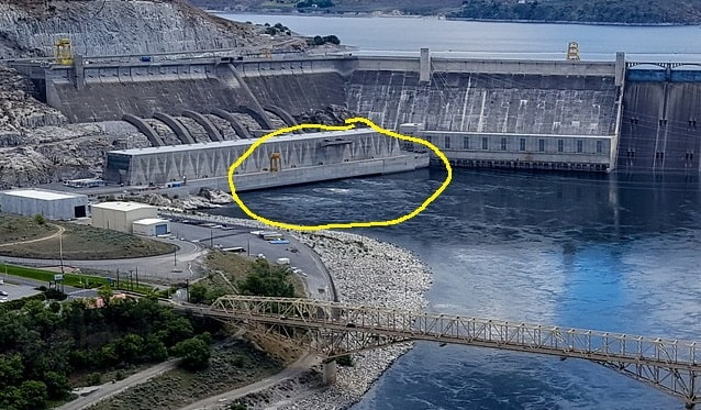 Enlarged section of title photo, showing where water emerges from the power generating plant
