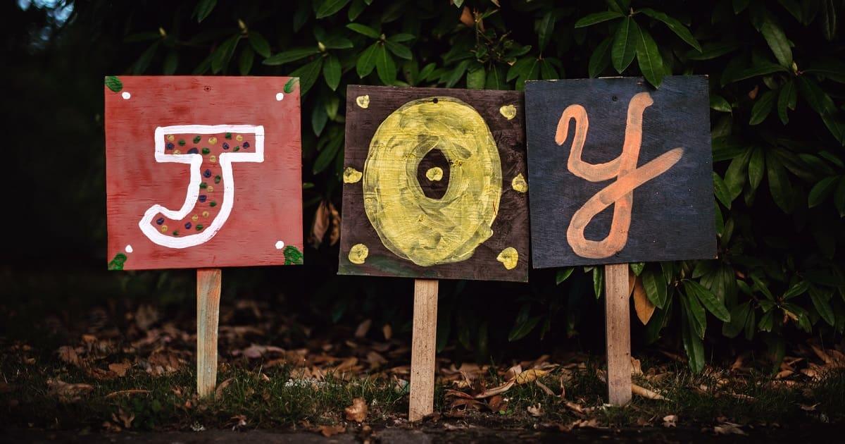 Painted signs spelling JOY