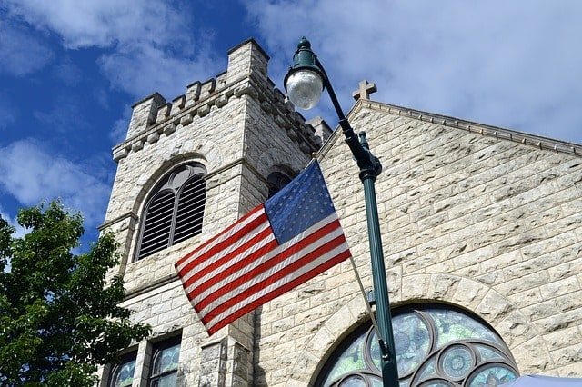 U.s. Flag flying in front of church