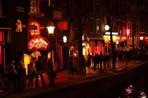People walking in front of Exotica Museum on Amsterdam street in Red Light District