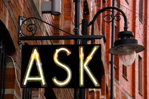 Neon sign that says ASK