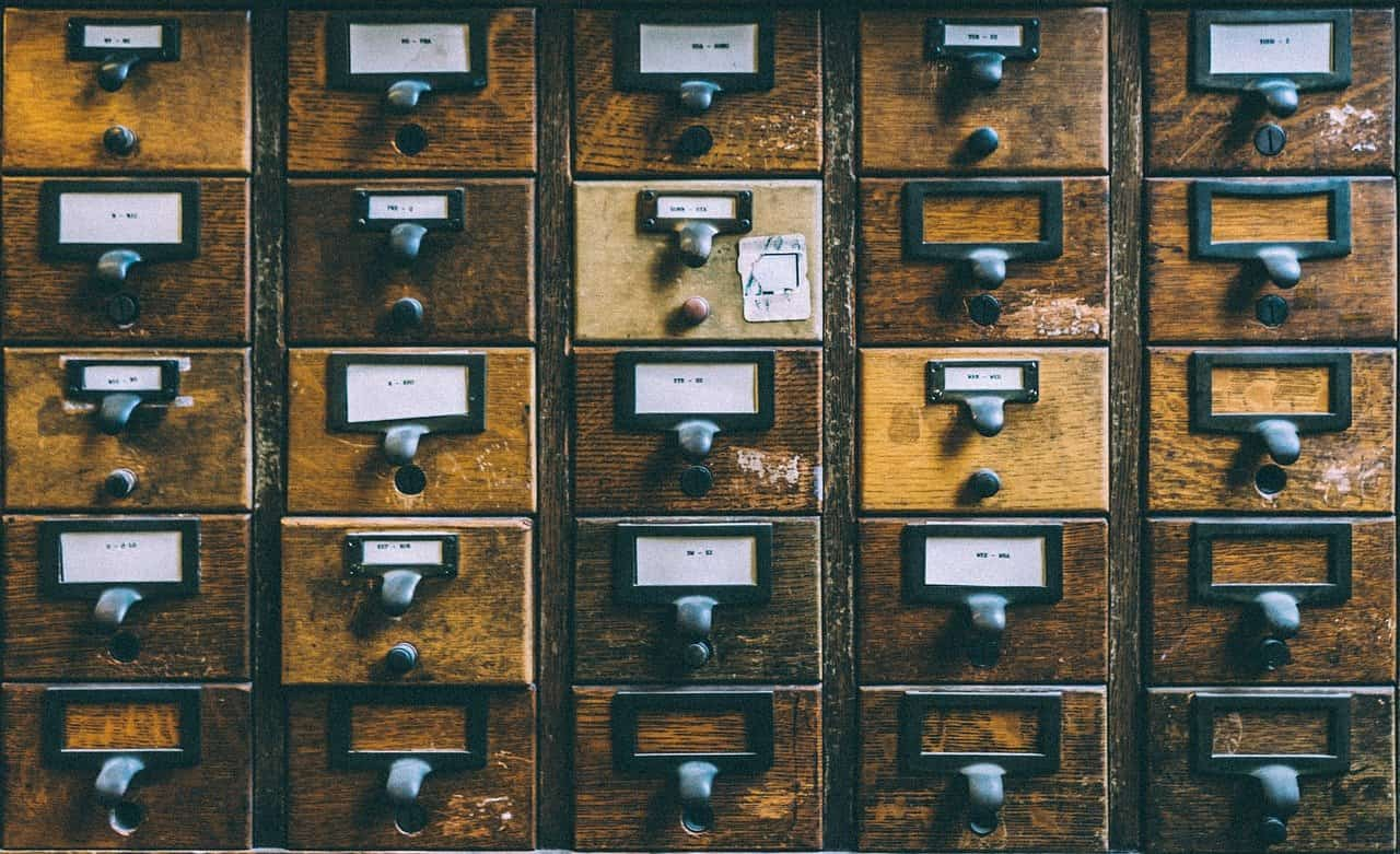 Old wooden library card catalogue drawers with labels