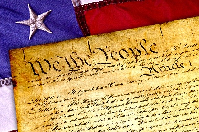 The Preamble of the Constitution laid over an American flag