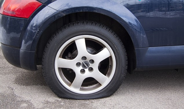 very flat tire on a car