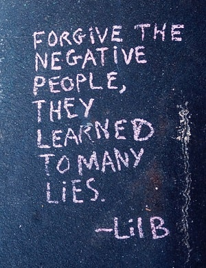 words written in chalk on street say FORGIVE THE NEGATIVE PEOPLE, THEY LEARNED TOO MANY LIES by Lil B