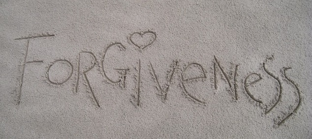 Photo of the word Forgiveness written in sand