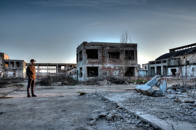 man standing in deserted area