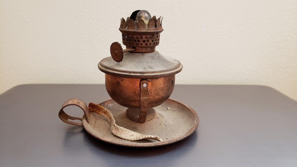 Broken copper oil lamp