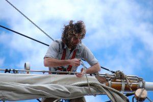 Sailor tending a sail