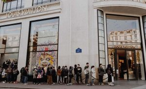People lined up to enter a Louis Vuitton store