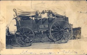 old wagon with people in it