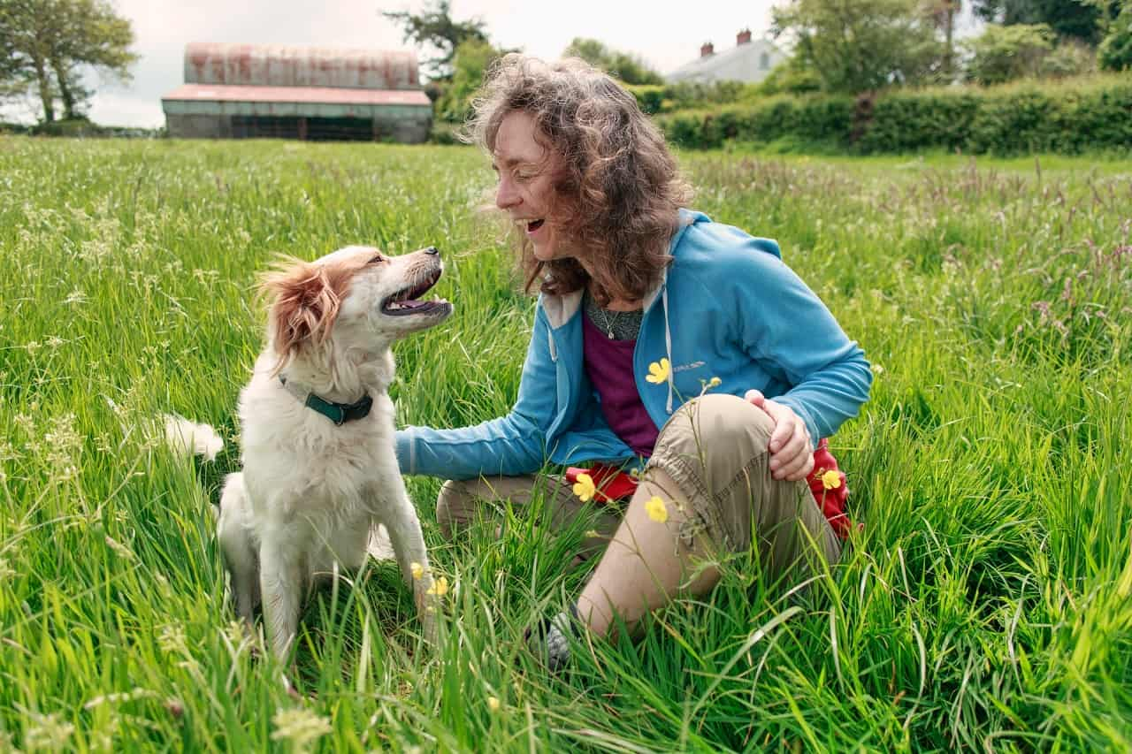 Woman and dog laughing together