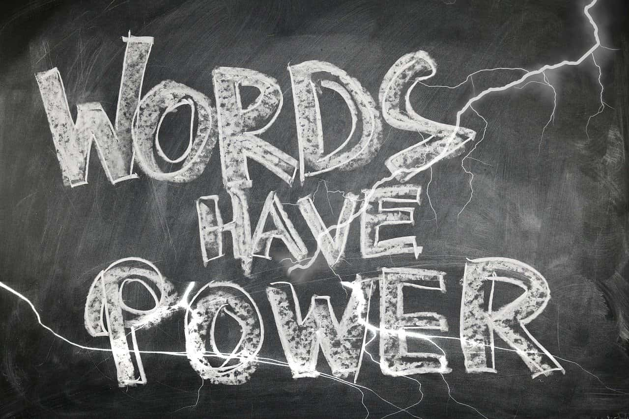 Black chalkboard with Words Have Power written in white