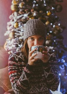 Sweater girl drinking from mug