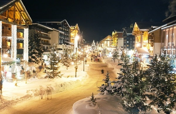 Snowy village with white Christmas lights